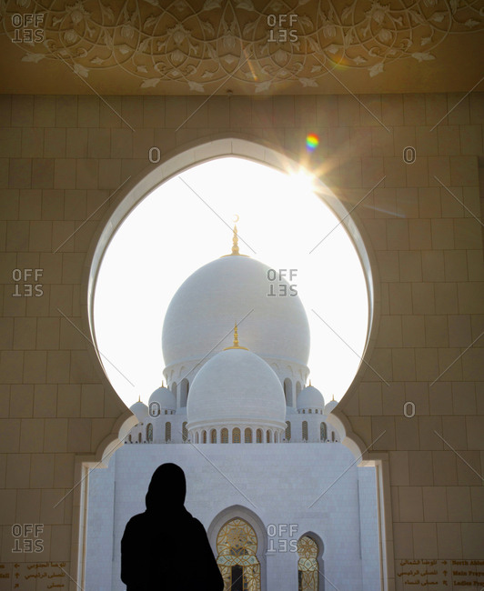 Woman looking at Sheikh Fayed mosque, Abu Dhabi, UAE