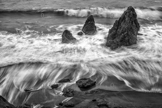 Waves moving among rocks, California