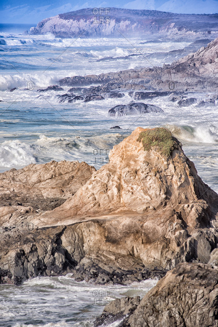 A rocky coastline with waves, California