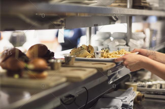 Serving up burgers in restaurant