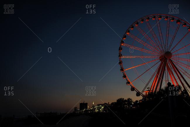 View of Ferris wheel at night