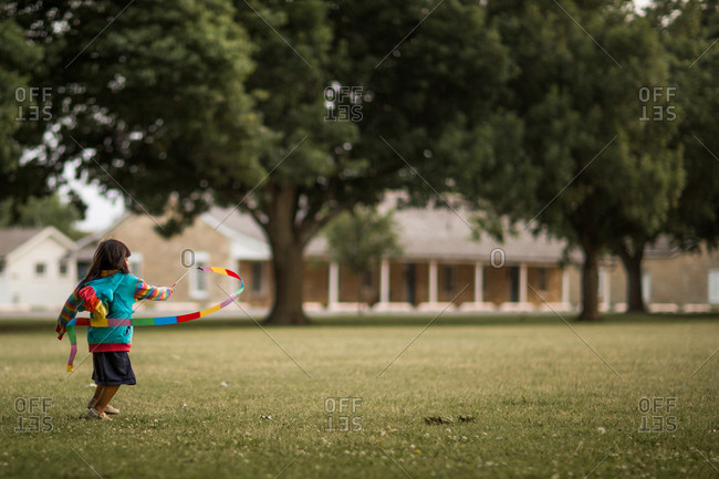 Girl twirling a colorful ribbon