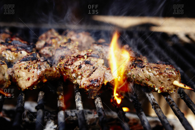 Close-up of lamb grilling on barbecue
