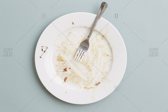Top shot of an empty plate on blue background