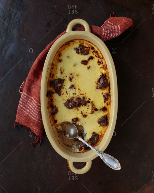 Savory custard with beef missing a portion