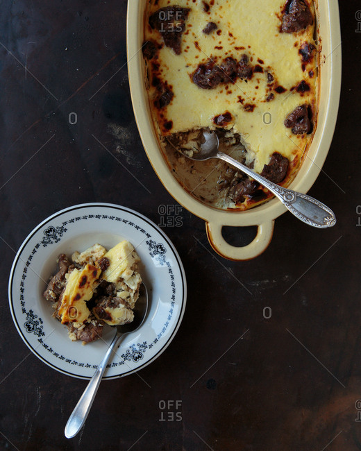 Savory custard with beef being served in a bowl