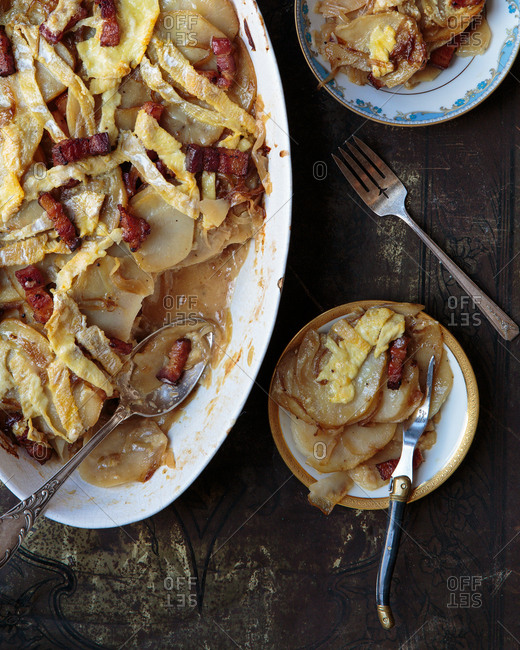 Scalloped potatoes being served on plates