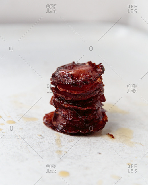 Cooked pepperoni in a stack
