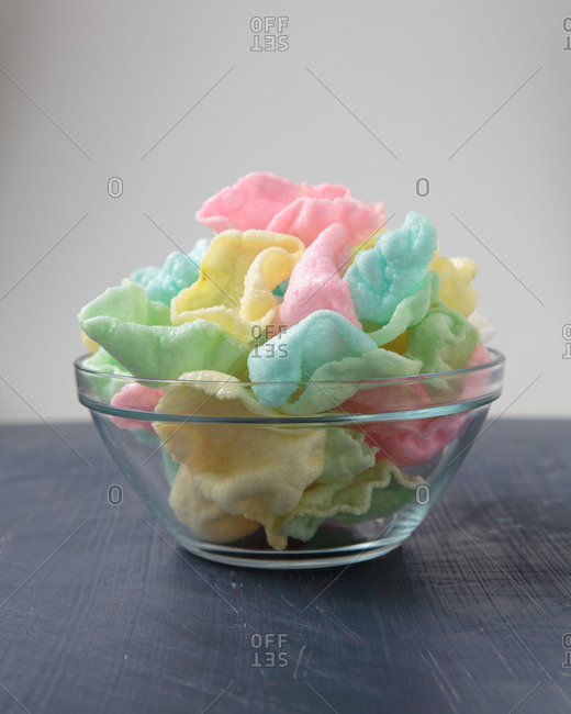 Pastel colored shrimp puffs in a bowl