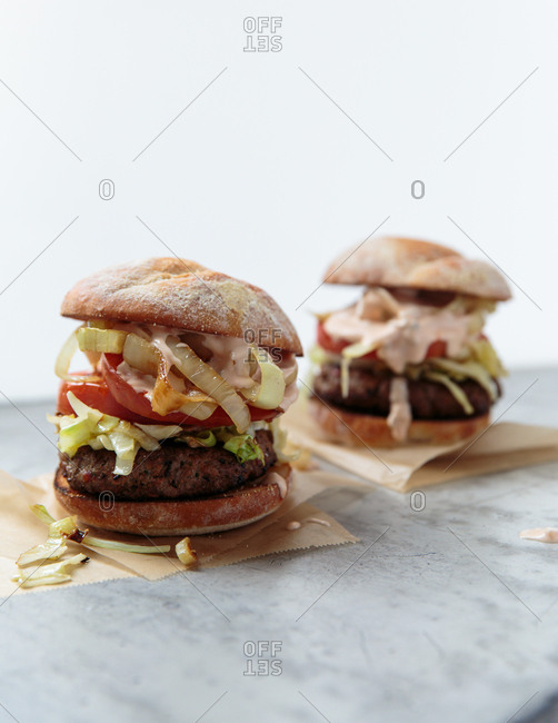 Hamburgers with onion, lettuce and tomato