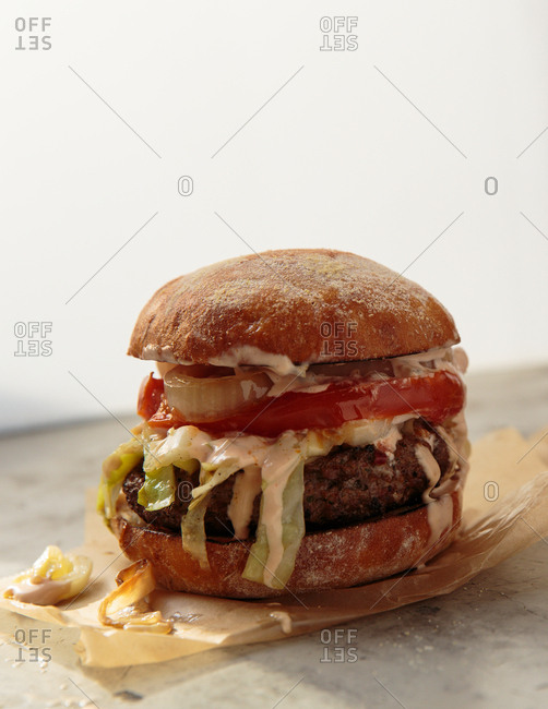 Hamburger with onion, lettuce and tomato