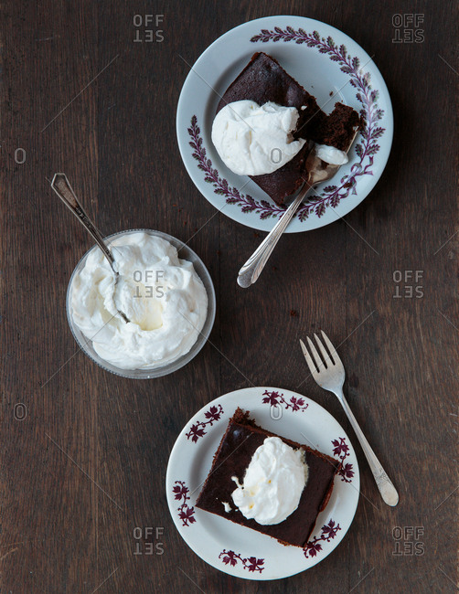 Chocolate brownies topped with whipped cream