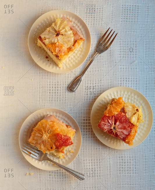 Plated squares of multicolored grapefruit cake
