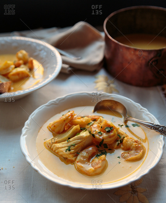 Shrimp and fish bisque in bowls