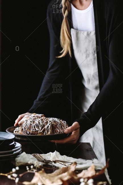 Woman serving breakfast buns