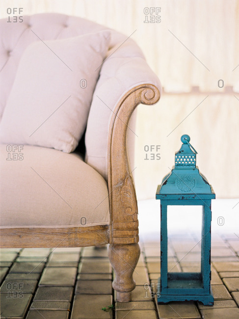 Lantern by antique sofa