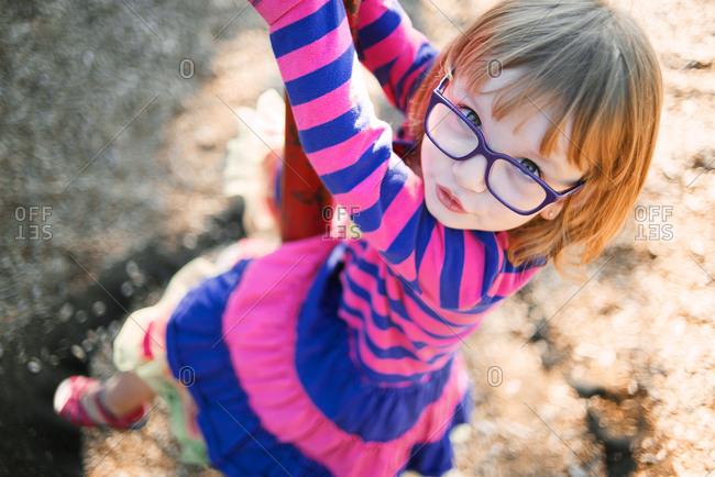 Girl in glasses looks at camera