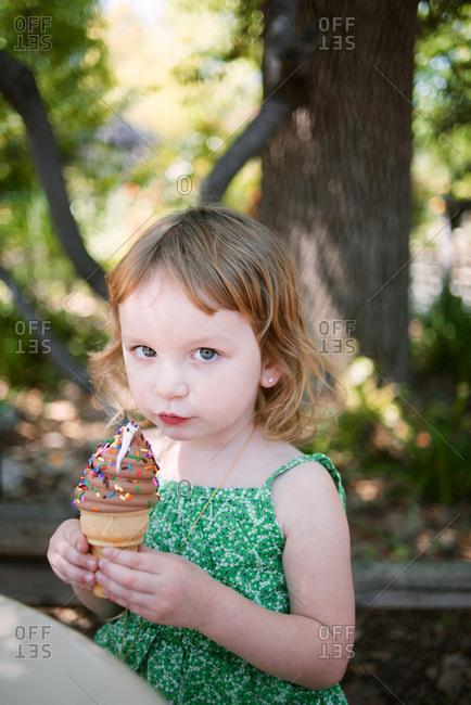 Girl holding up an ice cream cone
