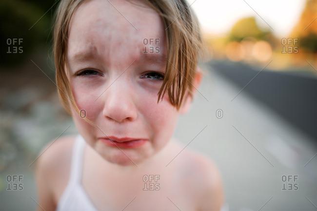 Girl sobbing on rural road