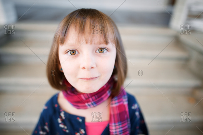 Girl with brown eyes in scarf