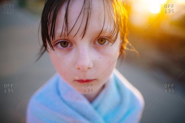 Girl in towel looking at camera