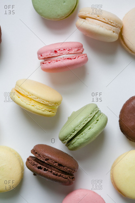 Various macaroon cookies on light background