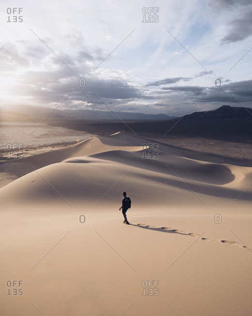 Person walking in Death Valley dunes