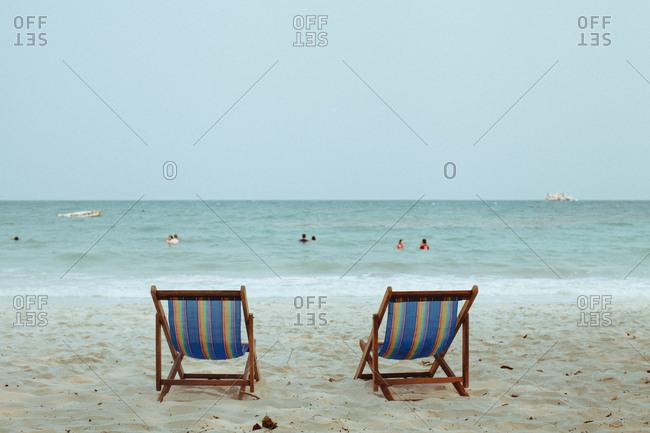 Striped beach chairs on beach