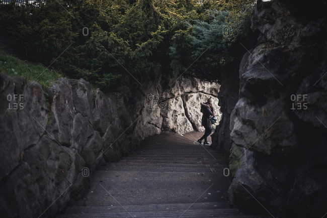 Unrecognizable person walking downstairs in a rock Horizontal outdoors shot