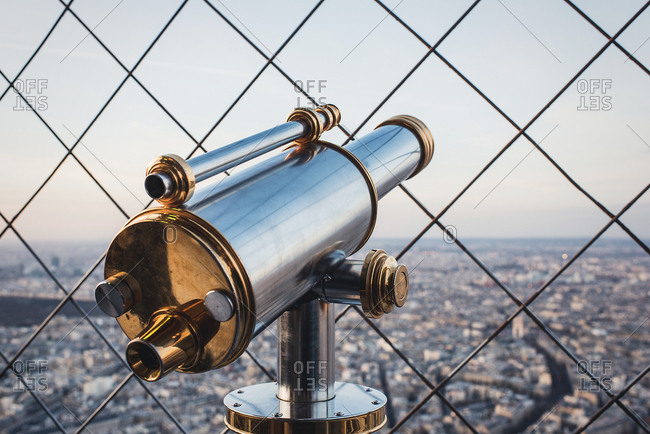 Binoscope through the metal grid showing the city view Horizontal outdoors shot