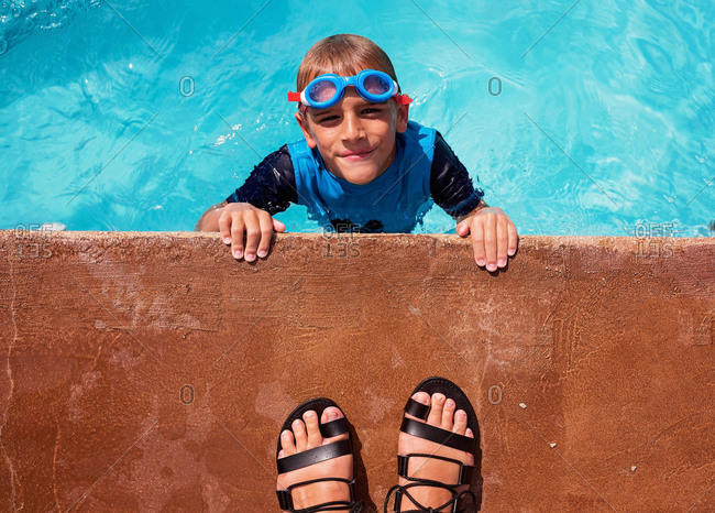 Boy looking up from in swimming pool