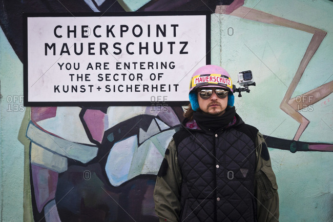 Berlin, Germany - March 17, 2013: An artist at the East Side Gallery in Berlin, Germany.