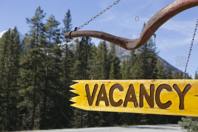 Rustic vacancy sign in front of a remote landscape