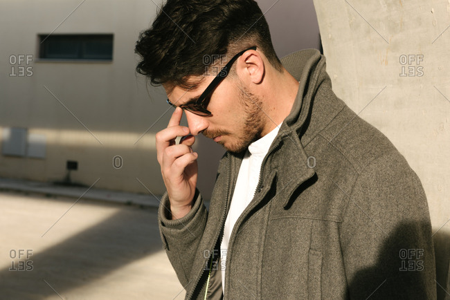 Man in sunglasses in shadows