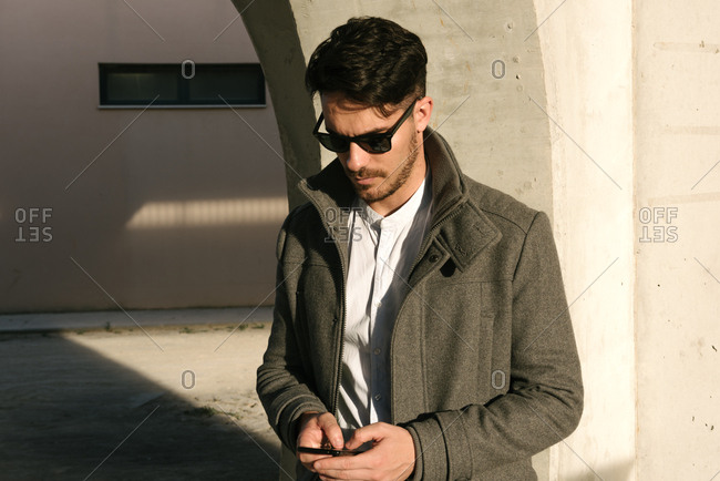 Man using his phone in building