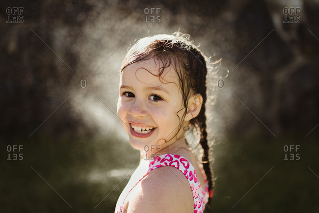 Little girl smiling with wet pigtails
