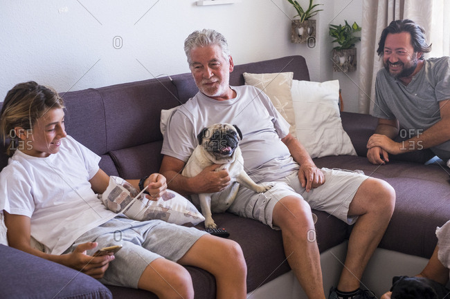 Two men and boy lounging on couch