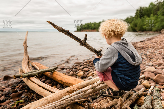 Boy on a branch structure, Madeline Island, Wisconsin