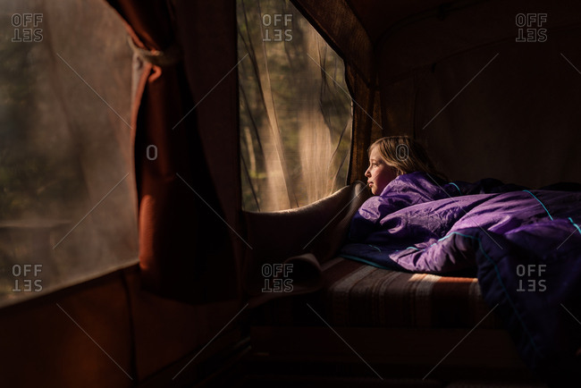 Girl looking out her tent window