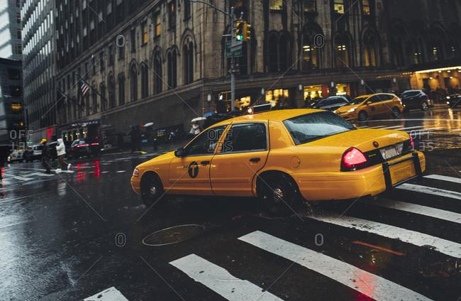 New York, NY - November 15, 2016, Yellow cab in a rainy day in Manhattan