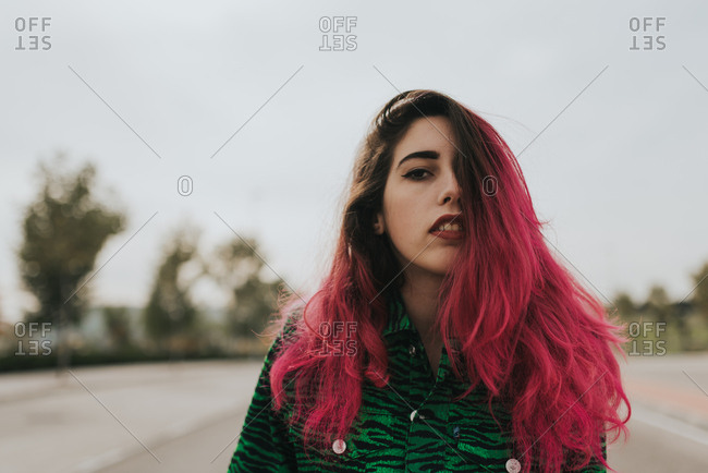 Punk teenage girl with pink hair
