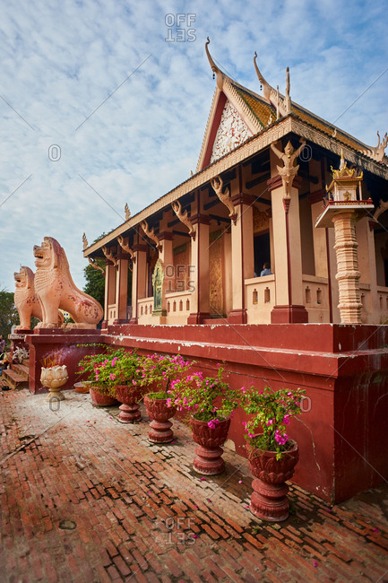 Phnom Penh, Cambodia - January 7, 2017: View of Wat Phnom Buddhist Temple on a sunny day with tourists in the background