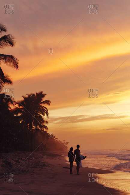 Couple watching sunset in the beach in Palomino, Colombia