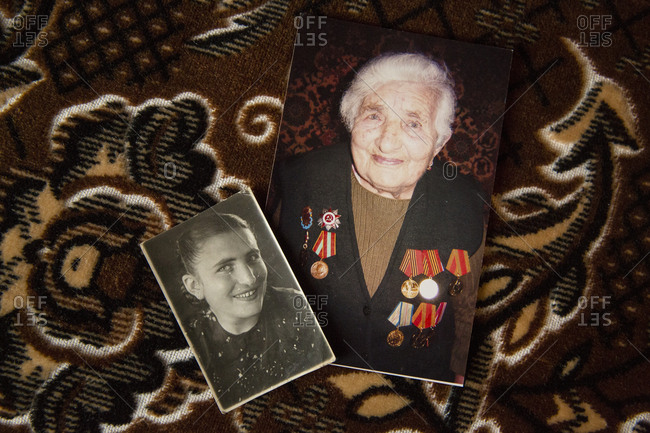 Gyumri, Armenia - March 11, 2016: Side-by-side photos of a senior Armenian woman and her younger self
