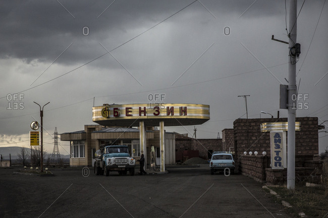 Gyumri, Armenia - March 11, 2016: Soviet-era gas station with vehicles parked outside