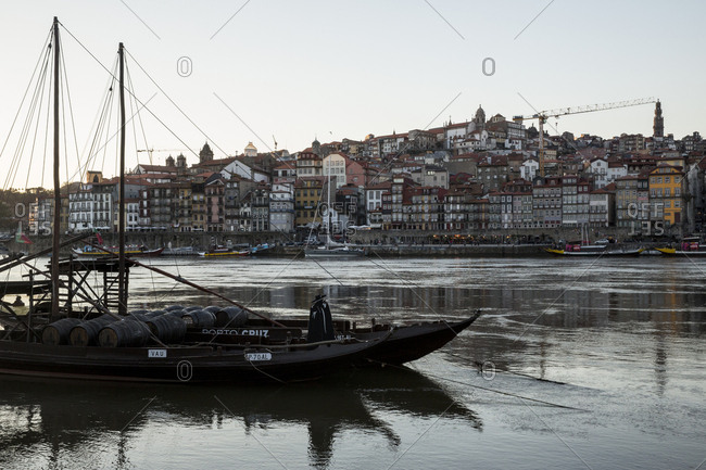 Porto, Portugal - April 23, 2016: Traditional rabelo boat docked on the waterfront at sunset