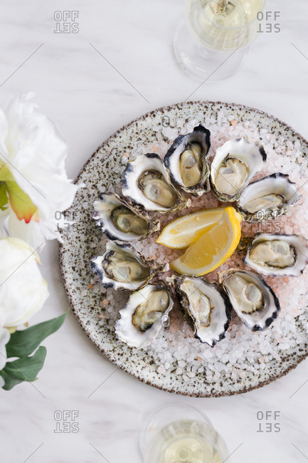 Platter of oysters in shells on a bed of ice