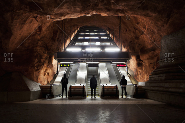 Stockholm, Sweden - January 15, 2014: Men standing in front of the escalators in Stockholm metro, the so called Tunnelbana