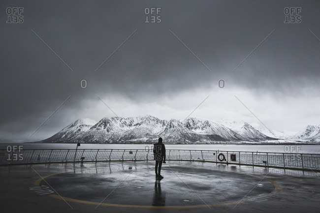 Norway - April 13, 2015 A man is enjoying the mountainous landscape of Norway