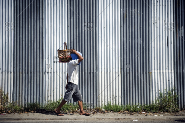 Venezuela - MAY 11, 2011: A man is carrying a basket on his shoulder